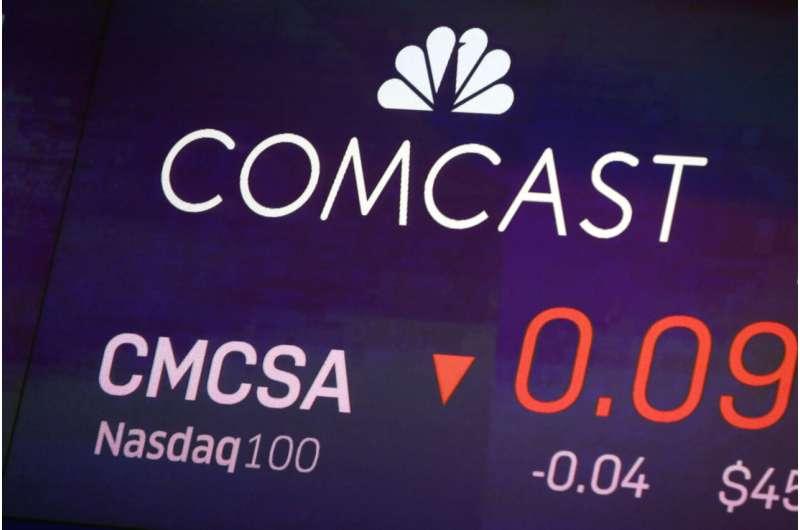 Comcast profit slides as pandemic hits movies, theme parks
