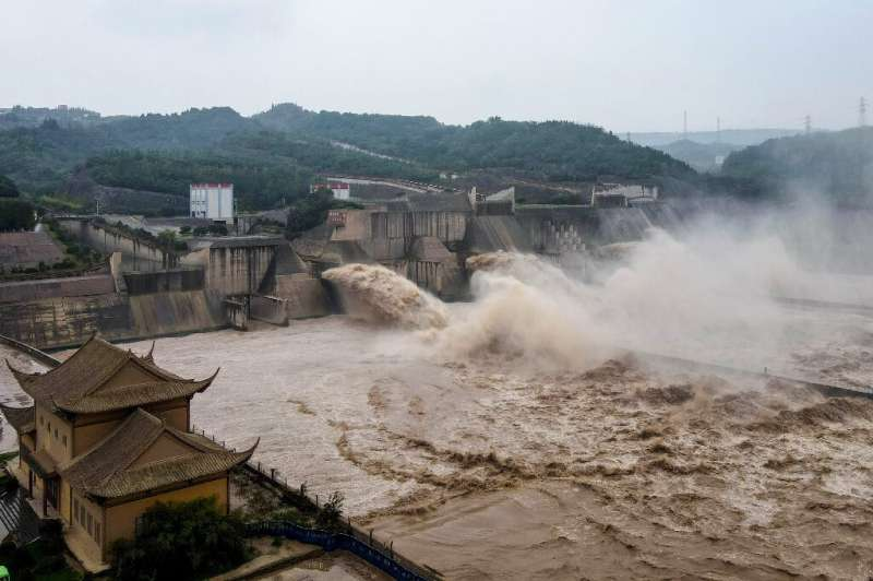 Dams such as the  Xiaolangdi Reservoir in Luoyang, central Henan province, have opened sluice gates to release upstream water pr