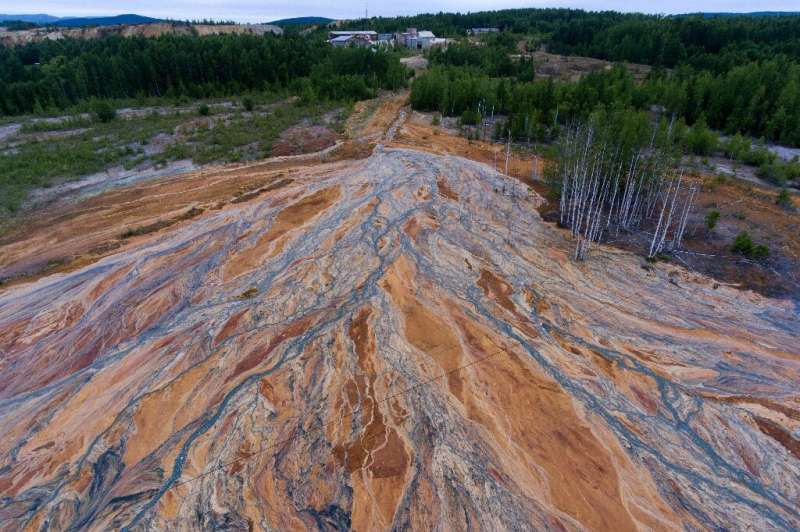 Drone footage uploaded last week by an Instagram travel blogger showed a bright-orange landscape near the disused copper-sulphid
