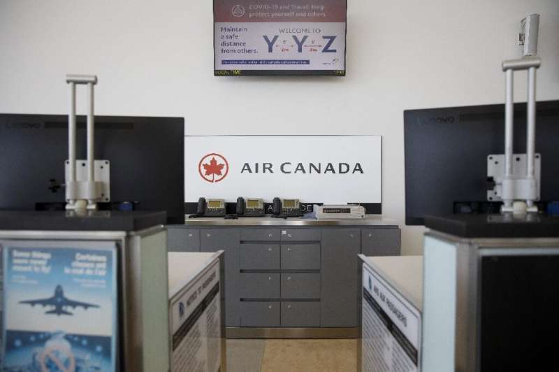 Empty Air Canada check-in counters are seen at Toronto Pearson International Airport—the company posted huge first-quarter losse