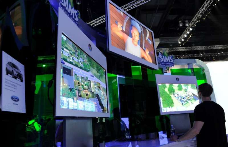 "(FILES) In this file photo taken on June 09, 2011 Gamers plays the video game ""Sims"" at the Electronic Entertainment E"