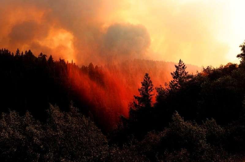 Fire retardant hangs in the air in Healdsburg, California