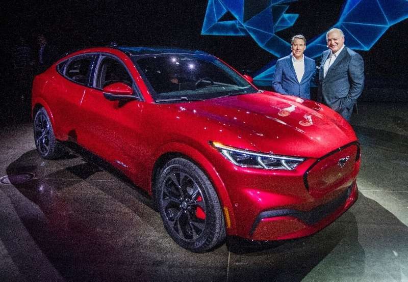 Ford CEO James Hackett (R), shown here at the November 2019 unveiling of the Mustang Mach-E, vowed that the all-electric vehicle