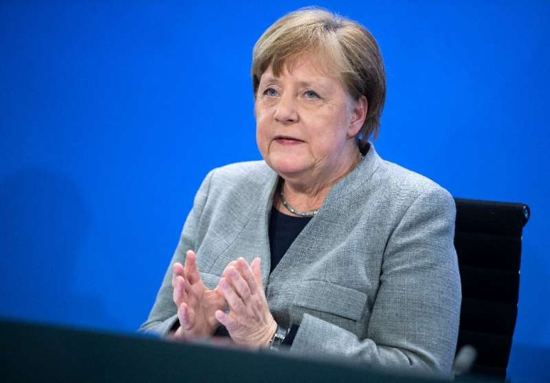 German Chancellor Angela Merkel addresses a press conference on German government's measures to avoid further spread of the nove