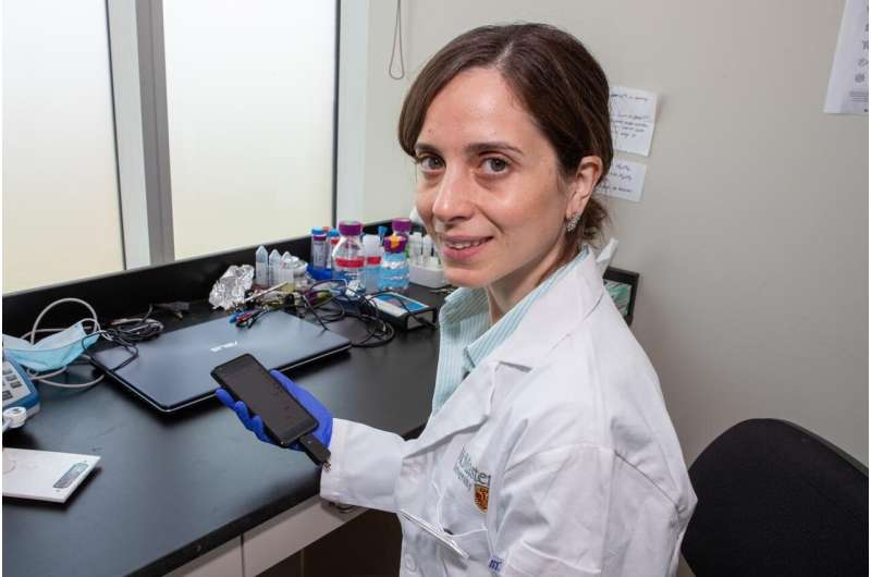 Hand-held device reads levels of cancer biomarker