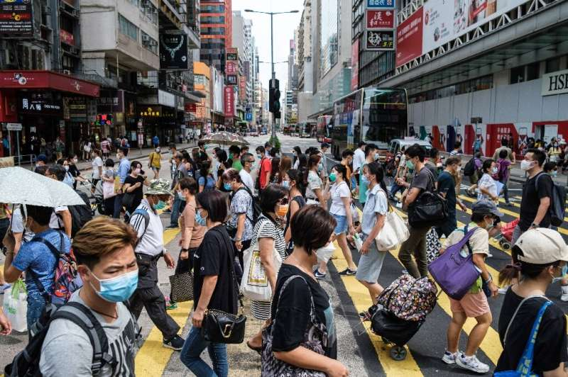 Hong Kongers were early adopters of widespread mask wearing, but now the government has made it compulsory even when outdoors, a