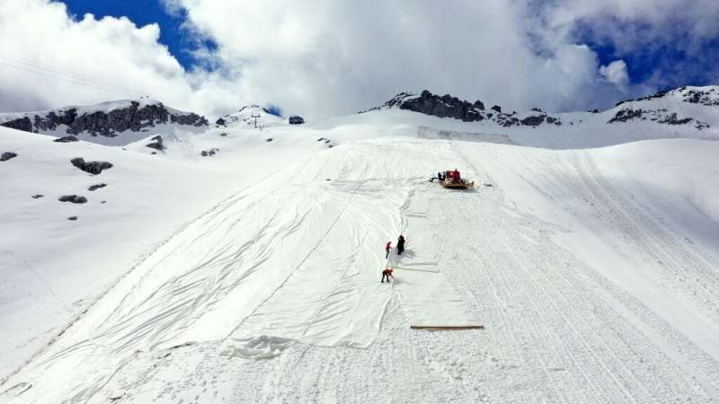 Huge white tarpaulins help protect the Presena glacier from melting during summer in the Italian Alps
