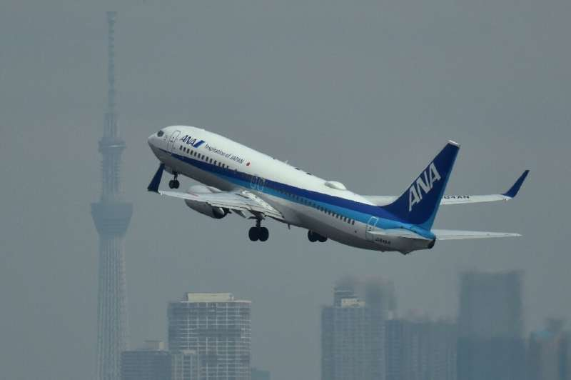Japan's ANA saw annual net profit plunge as the coronavirus cut demand and forced cancellations worldwide