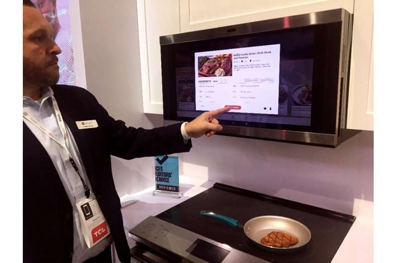 Jeremy Miller of GE Appliances shows a smart hub which uses artificial intelligence to help consumers with meal planning and pre