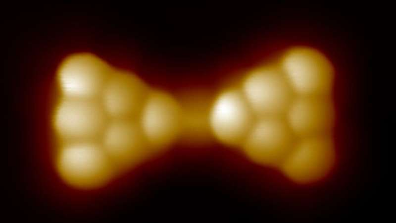 Joined nano-triangles pave the way to magnetic carbon materials