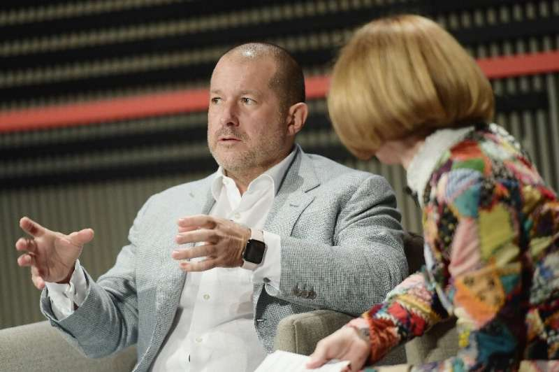 Jony Ive (L), pictured in October 2018, will join forces with Airbnb
