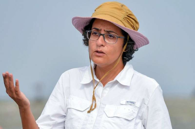 Mahera Omar, an environmental filmmaker, speaks during an interview with AFP on Bundle Island