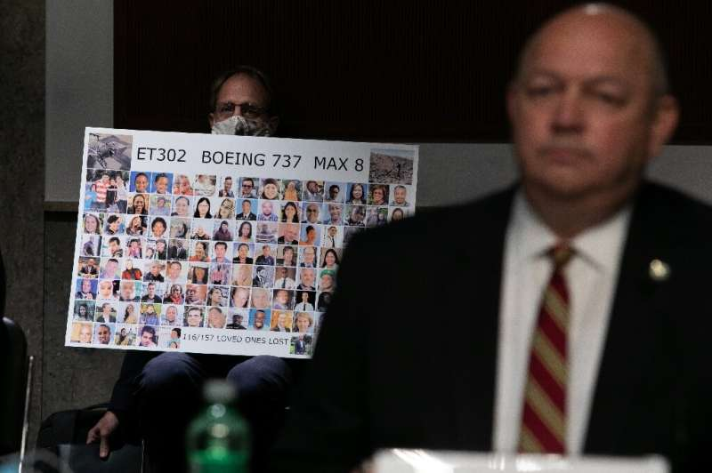 Michael Stumo holds a sign displaying photographs of the those killed in the March 10, 2019 crash of Ethiopian Airlines Flight 3
