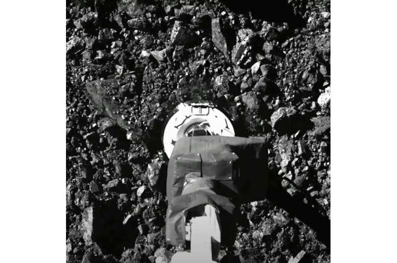 NASA spacecraft sent asteroid rubble flying in sample grab