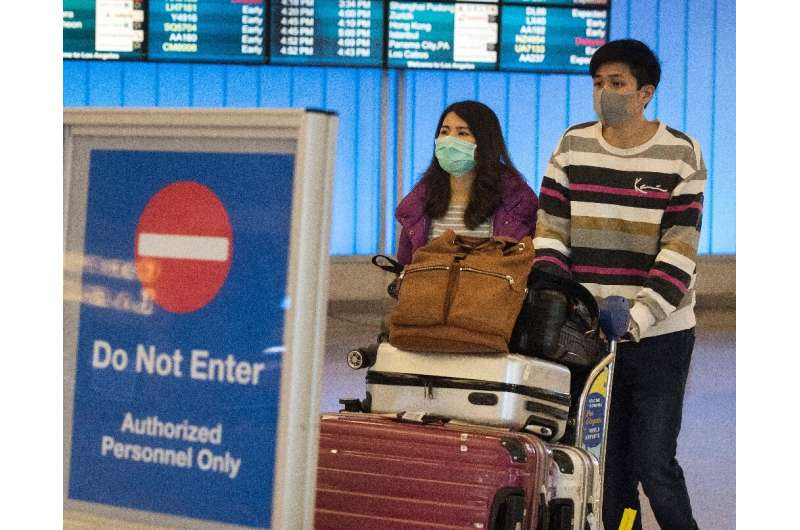Passengers wearing protective masks arriving at Los Angeles International Airport in California