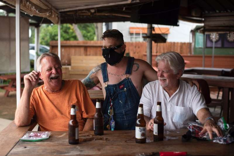 Patrons at the West Alabama Ice House in Houston have beers before Texas Governor Greg Abbott's order that all bars are to be cl