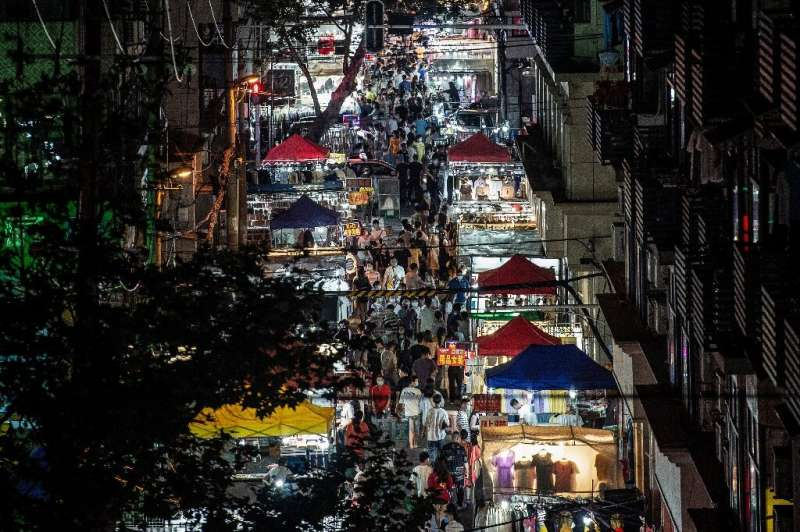 People visit a night market in Wuhan in China's central Hubei province on June 3