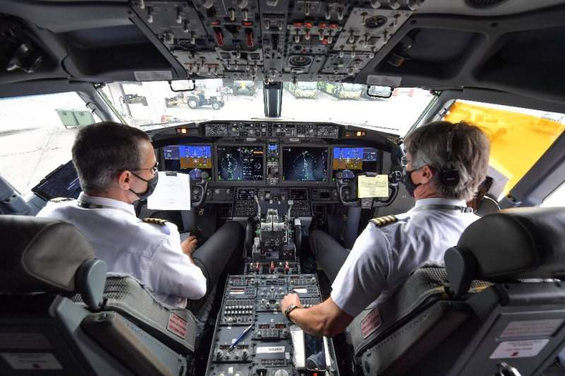 Pilots are pictured in the cockpit of a Boeing 737 MAX aircraft operated by low-cost airline Gol as it sits on the tarmac before
