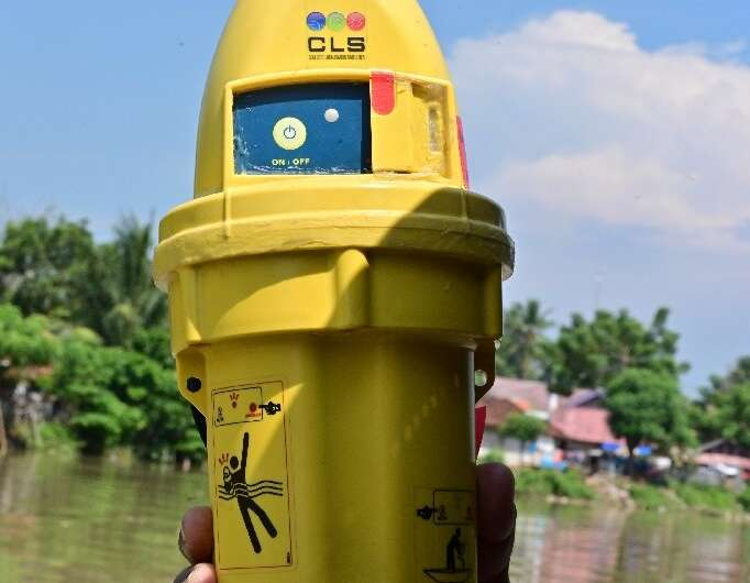 Plastic satellite beacons like this one are wrapped in waterproof covers and tossed into the mouths of rivers; they then transmi