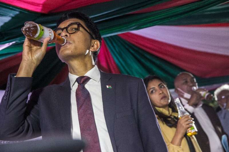 Promoter: President Andry Rajoelina drinks from a bottle of Covid-Organics at the product's launch on April 22