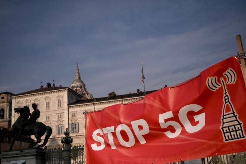 Protests against 5G mobile services, like this one in the northern city of Turin in Janaury, are just one of the worries operato