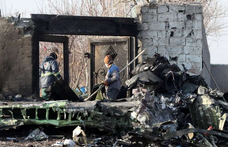 Rescue teams work after a Ukrainian plane carrying 176 passengers crashed in the Iranian capital Tehran early in the morning of