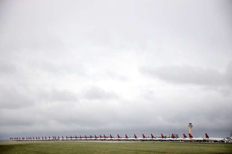 Runways have become parking lots at some airports as airlines ground most of their planes