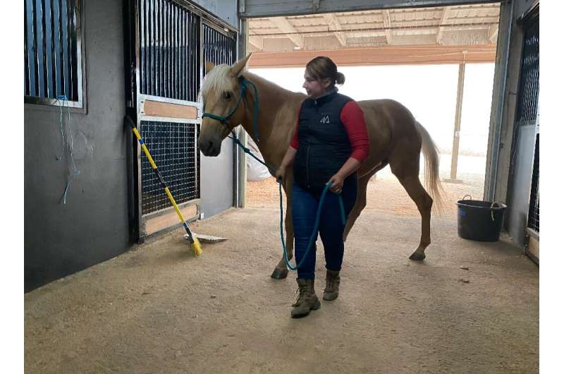 Sarah Anderson and her warm springs mustang Ezzy found shelter from the fires at the Mount Hood Center in Boring, Oregon