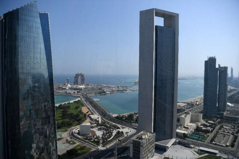 Sea front promenade in the Emirati capital Abu Dhabi with the ADNOC headquarters (Abu Dhabi National Oil Company) office complex