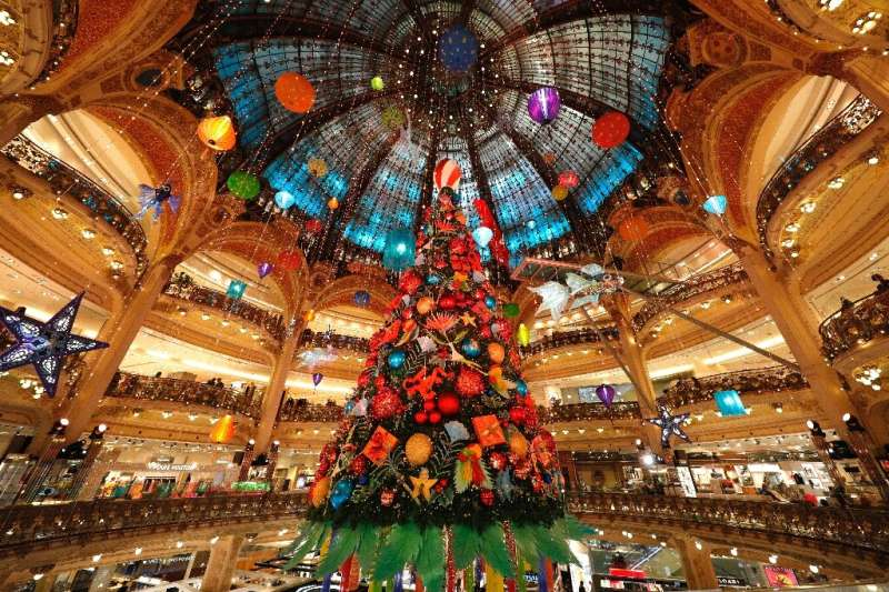 Shoppers flocked to the Galeries Lafayette department store in Paris as it reopened on Saturday