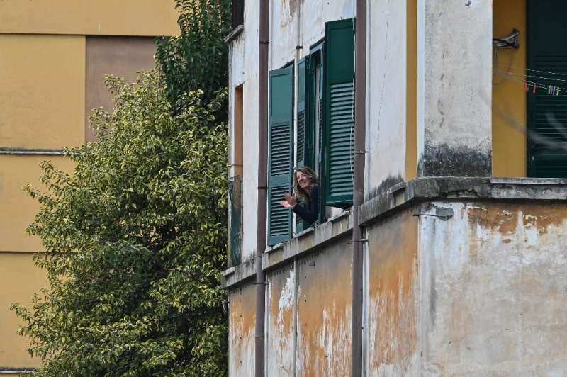 some Italians in Rome took to singing to each other from their windows to beat the social isolation, others organised rounds of