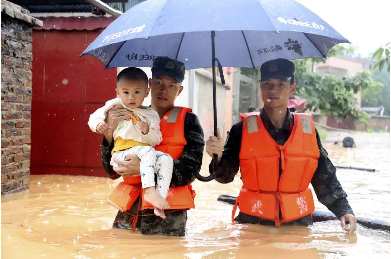 South China cleaning up from floods but more rain on the way