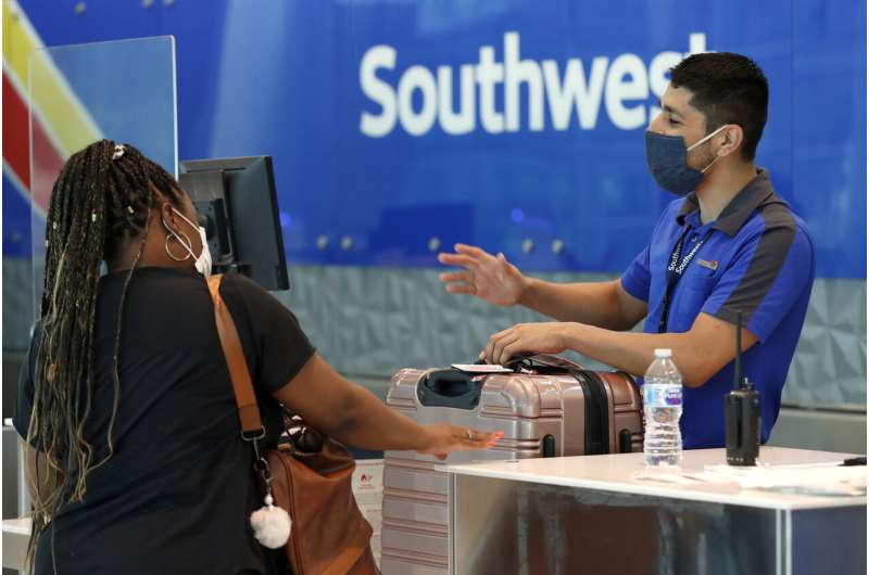 Southwest report shows rising virus cases are hitting travel