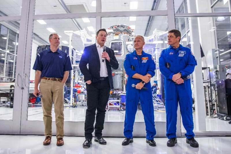 SpaceX founder Elon Musk (2nd L) addresses the media alongside NASA Administrator Jim Bridenstine (L), and astronauts Doug Hurle