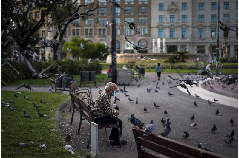 Spain says 'tough weeks' ahead as Madrid hit hard by virus