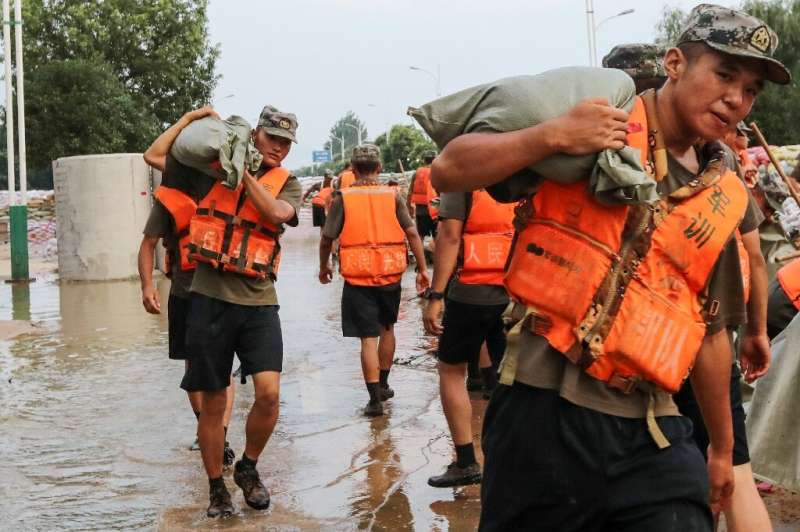 State media reported that more than 100,000 people—including rescue personnel, soldiers, and ordinary citizens—had been thrown i