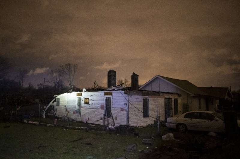 Storm damaged houses stand in portion on Underwood St. on March 3, 2020 in Nashville, Tennessee