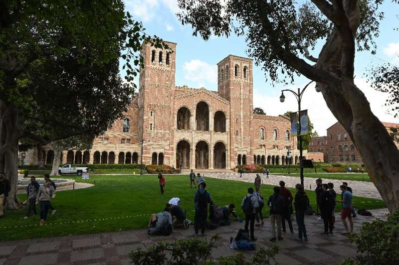 Students gather on the campus of University of California at Los Angeles (UCLA) in Los Angeles, among the schools suspending in-