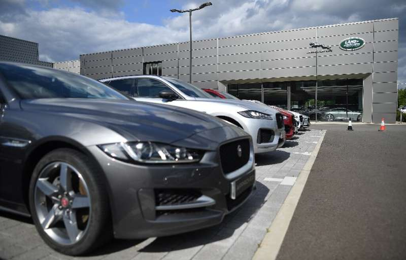 Tata's luxury car unit Jaguar Land Rover faced sales challenges in its key markets China and Europe, worsened by the virus sprea