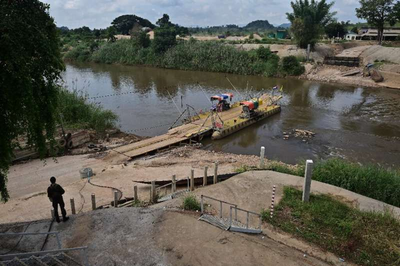 Thai soldiers guard a river crossing between Thailand and Myanmar in the border town of Mae Sot in Tak province in late October