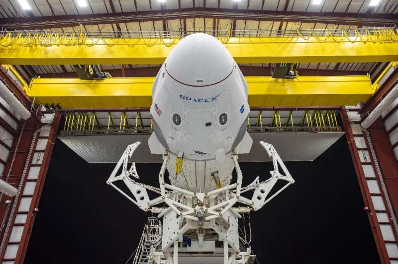 The Crew Dragon spacecraft and the SpaceX Falcon 9 rocket are pictured at Launch Complex 39A at Kennedy Space Center in Florida