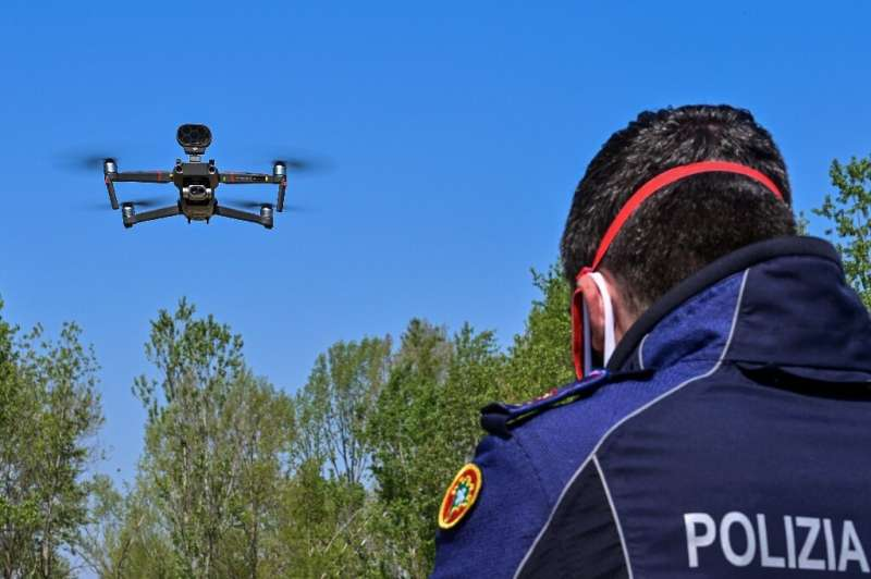 The drones order people away from restricted areas