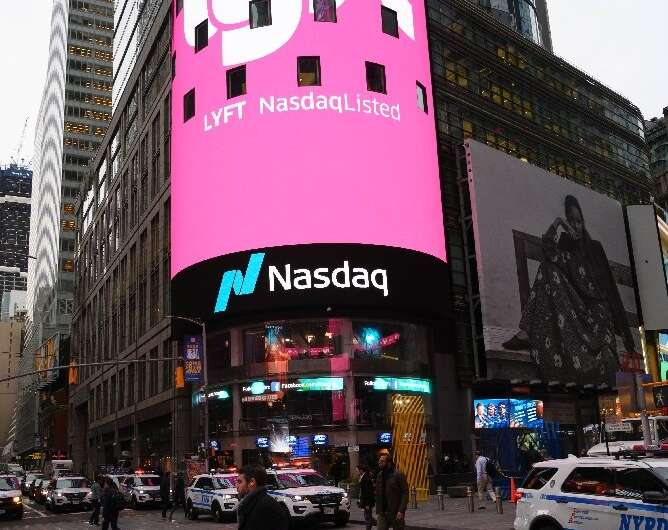 The Lyft logo is shown on the screen at the Nasdaq offices in Times Square in New York City