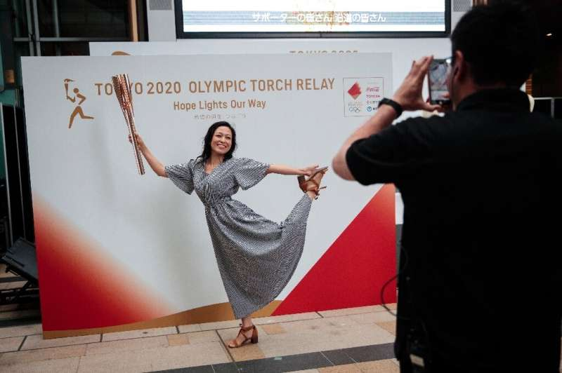 The Olympic torch relay will travel though many of the areas devastated by the disaster, under the slogan 'Hope Lights Our Way'