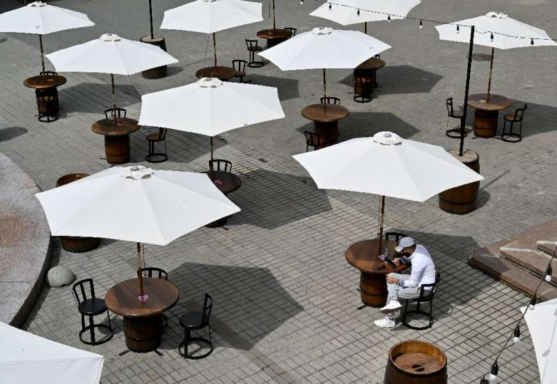 The seats outside this cafe in Kiev are the requisite distance apart