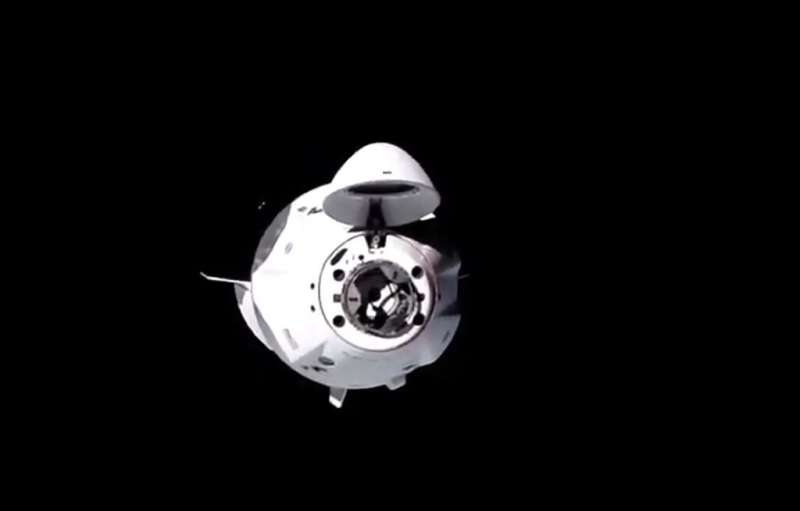 "The spacecraft, named ""Resilience,"" docked autonomously with the space station some 260 miles (400 kilometers) above t"
