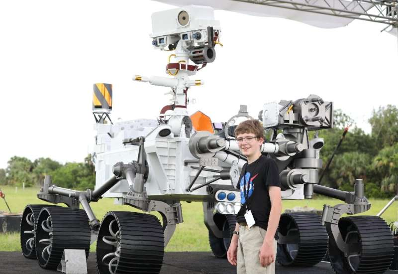 Thirteen-year-old Alex Mather, who won a national competition to name NASA's latest rover Persverance, speaks to the media in fr
