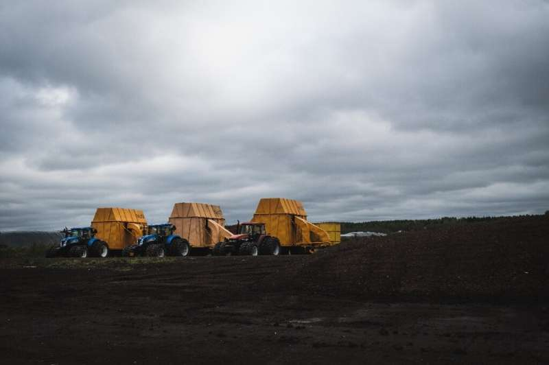 Tractors and peat faming machineries are lined up in Taisto Raussi's peat fields in Sippola, Finland