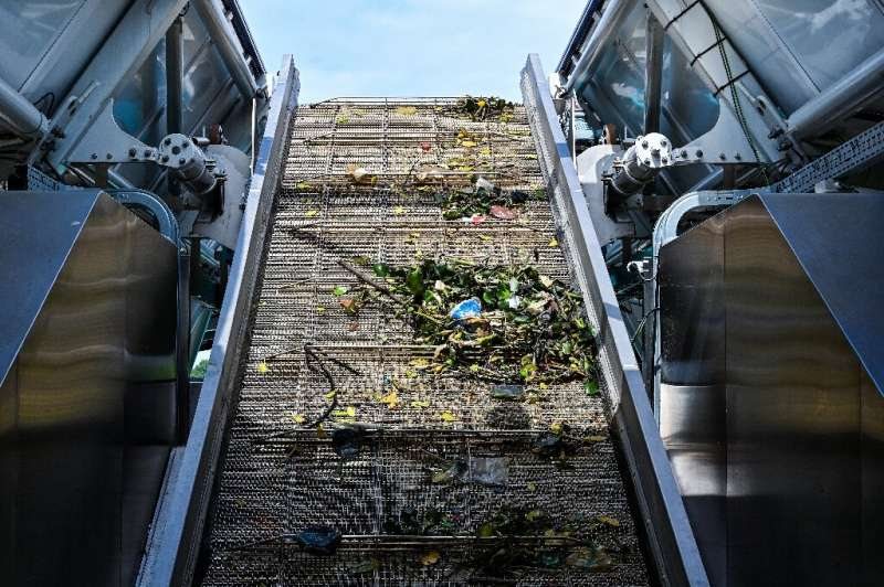 Trash collected by the Interceptor barge rolls up a conveyor belt before being dropped into dumpsters