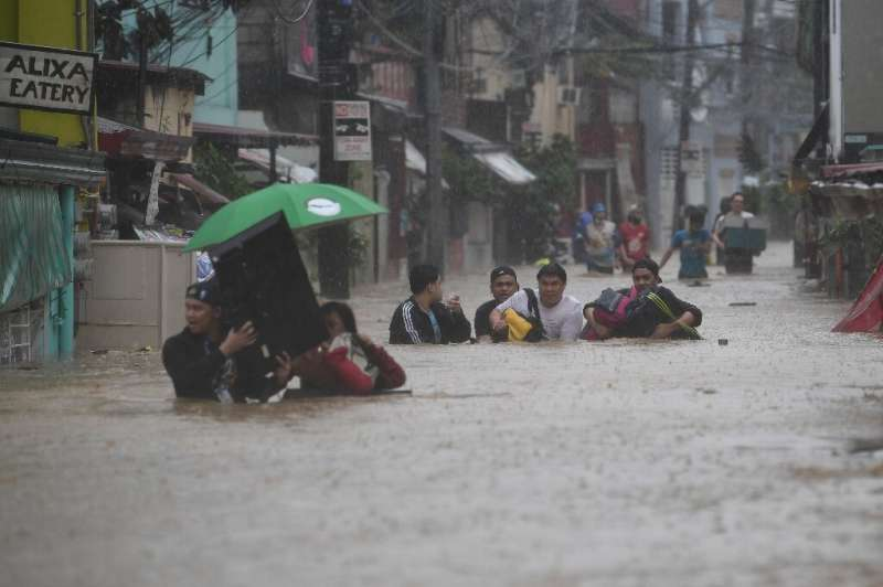 Typhoon Vamco brought heavy flooding to suburban Manila on Thursday, with authorities warning of life-threatening storm surges o